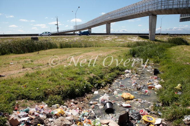 The N2 national road passes the informal settlement (township) of Khayelitsha, Cape Town, South Africa