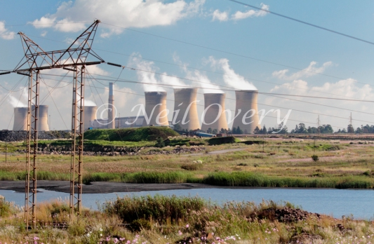 Eskom's coal-fired Hendrina Power station with power cables and polluted dam, Hendrina, Mpumalanga, South Africa