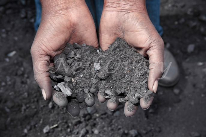 Financially poor South Africans collect waste coal to use domestically for cooking and heating, Witbank, Mpumalanga, South Africa