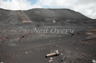 A massive pile of coal slag from a coal mine in Mpumalanga, South Africa. Despite commitments to rehabilitate mines, few mining housing bother, leaving communities to deal with all the health and safety problems they pose.