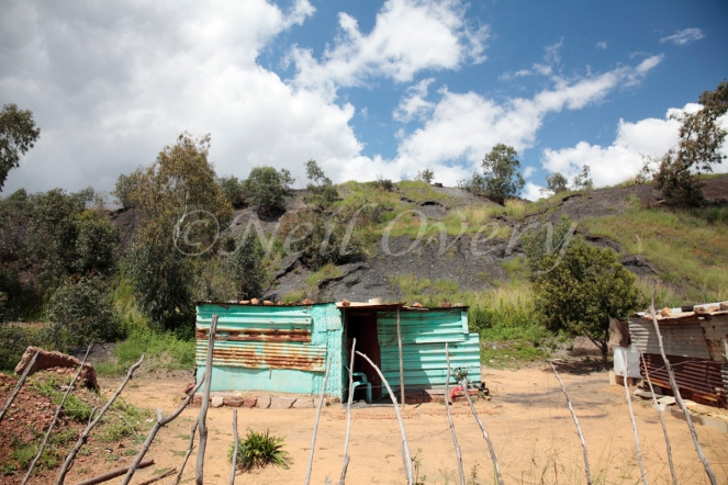 People living near an abandoned coal mine slag heap, nr. Witbank, Mpumalanga, South Africa - such slag heaps often contain highly toxic heavy metals and pose a serious health risk. They are also supject to collapse.