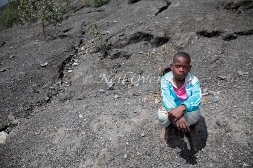 A boy plays on a massive pile of coal slag from a coal mine in Mpumalanga, South Africa. Despite commitments to rehabilitate mines, few mining housing bother, leaving communities to deal with all the health and safety problems they pose.