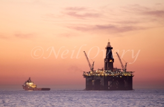 The Eirik Raude Deep Water Drilling Rig moored off Cape Town, South Africa. The Eirik Raude was completed in 2002. The hull was constructed at Dalian New Shipyard China and outfitted at Friede Goldman Offshore USA and in Canada by Irving Shipyard Halifax. The rig is currently equipped for drilling operations in water depths from 500 meters (1640 feet) to 2500 meters (8200 feet).