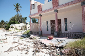 Sea level rises damage homes on the beach, Jambiani, Zanzibar