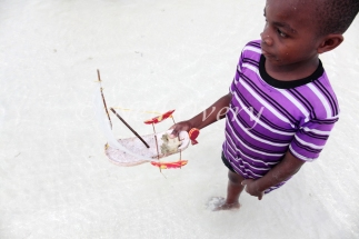 Children in Zanzibar race boats made from old sandals or flip-flops, a brilliant example of recycling.
