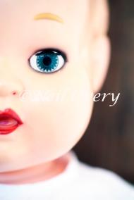 Face of creepy plastic doll