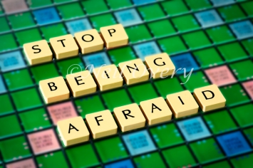 Stop being afraid written with scrabble tiles
