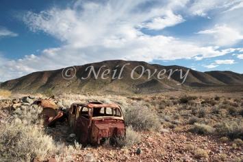 Cars slowly rusting in the Karoo Desert, nr Prince Albert, Western Cape, South Africa