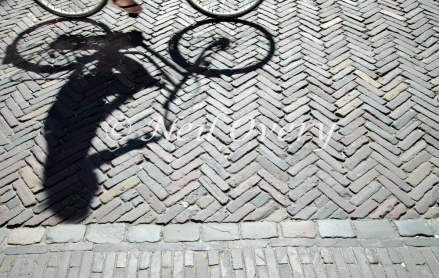 Reflection of someone cycling, Utrecht, Netherlands